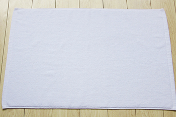 Plain white soft 100% cotton bath mat