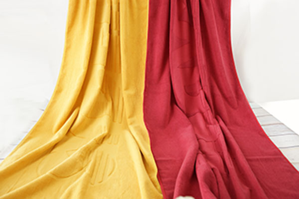 Very large jacquard yellow/ red pool bath towels