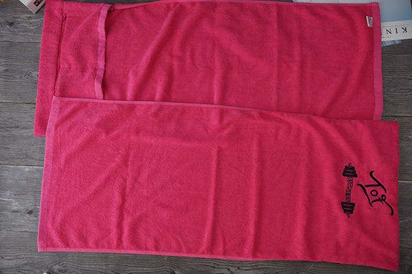 Cotton red color sports/fitness/gym terry towel with zip pocket