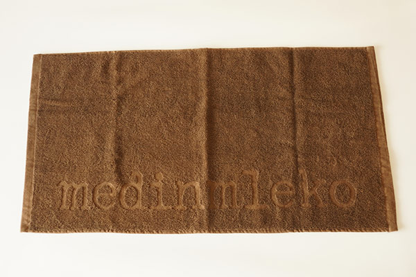 Brown bleach resisted hand towel,cotton embossed towel with logo